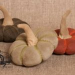 Small flattened pumpkins designed by Tish Bachleda. Shown in patterned dark green, autumn tan, and deep orange