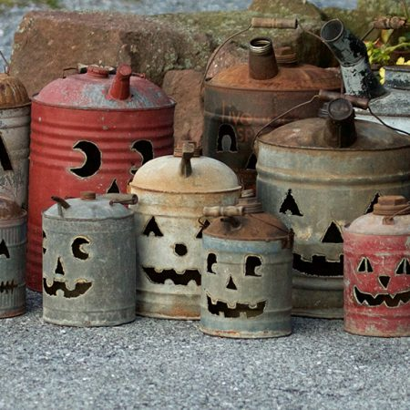 Vintage antique gas cans with jack-o-lantern faces cut into each by Tish, Mike and Ian Bachleda. Selection varies.