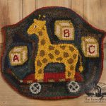 Giraffe and ABC Blocks chairpad design by Tish Bachleda