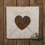 Two Rusty Steel Hearts Mounted on Vintage White Wood Frame design by Tish Bachleda