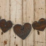 No. 0644 - Seven Rusted Steel Hearts Mounted on Wire design by Tish Bachleda