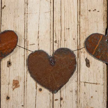 Three Rusted Steel Hearts Mounted on Wire design by Tish Bachleda